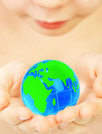 The boy holds globe in hands Stock Photo - 2880242
