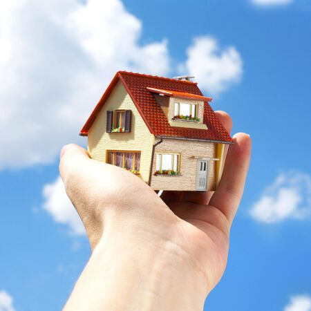 The house in human hands Stock Photo - 3210427