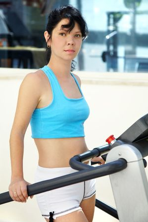 The girl in a sports hall. Fitness Stock Photo - 3357268