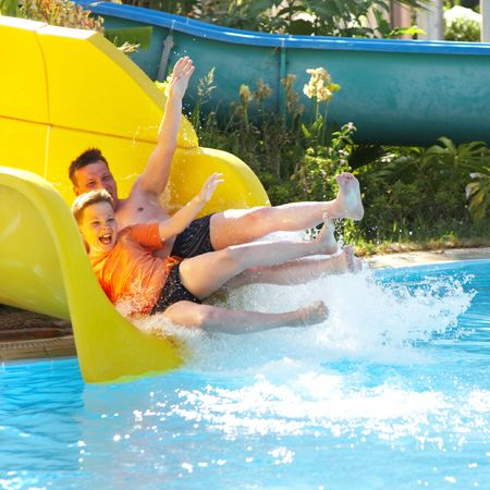 The father with the son on waterslide... Stock Photo