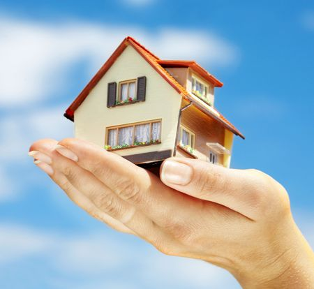 The house in human hands Stock Photo - 3417878