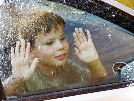 vehicle window: child and window on a wet rainy day ...
