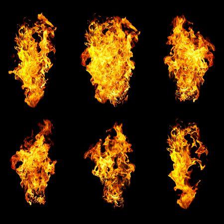 orange inferno: Fire photo on a black background ...   Stock Photo