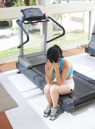 woe: girl cries at a sports training apparatus... Stock Photo