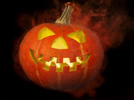 A scary old jack-o-lantern on black... photo