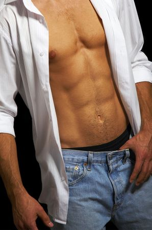 muscular build: Muscular male torso on a black  Stock Photo