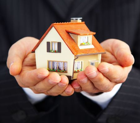 architecture detached house: Hand of the businessman with the house... Stock Photo