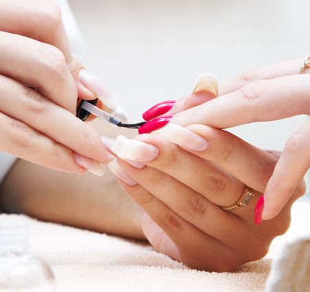 Manicure process... Female hands... photo