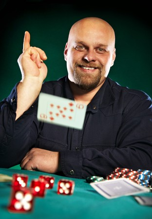 man with a beard plays poker... photo