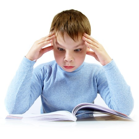 boy with the book behind a table... Stock Photo - 4166304