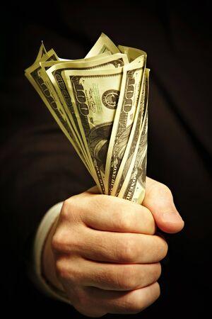 man's hand holds dollars... Stock Photo - 4362990