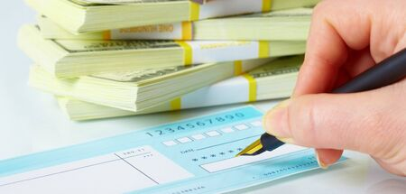blank check: Close up of a pen and blank check. Stock Photo