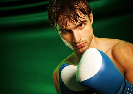 Man sweating all over in boxing gloves... Stock Photo - 4449837