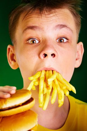 boy with meal in a mouth photo