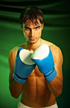 Man sweating all over in boxing gloves... Stock Photo - 4930810