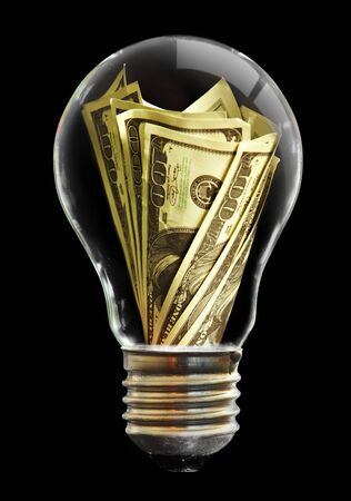 The light bulb  and dollar Stock Photo - 5000660