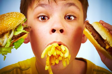 humorous: boy with meal in a mouth