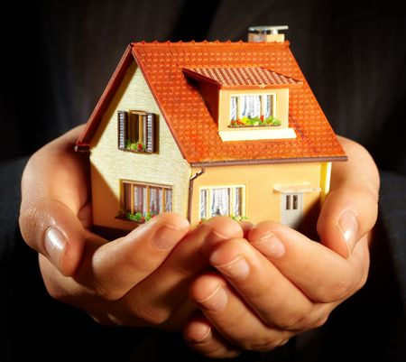 Hand of the businessman with the house... Stock Photo - 5151393