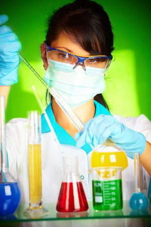 Young scientist in laboratory with test tubes photo