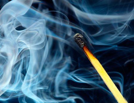 Match flame and smoke... photo
