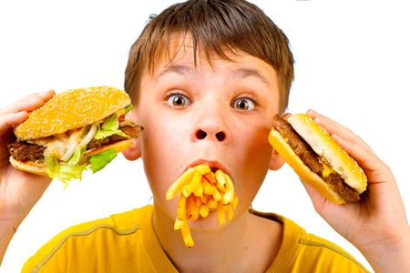 fast eat: boy with meal in a mouth