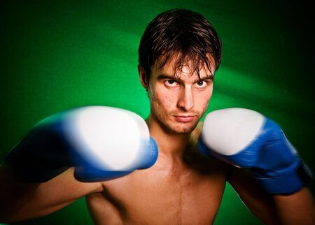 bloodsport: Man sweating all over in boxing gloves... Stock Photo