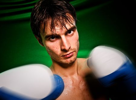 Man sweating all over in boxing gloves... Stock Photo - 5851511