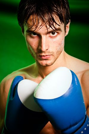 Man sweating all over in boxing gloves... Stock Photo - 5851513