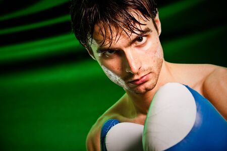Man sweating all over in boxing gloves... Stock Photo