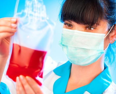 doctor with a package of donor blood Stock Photo - 5851531