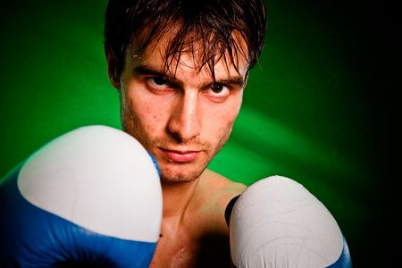 Man sweating all over in boxing gloves... Stock Photo - 6236183