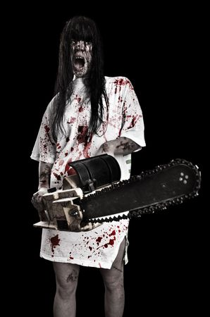 horrific:  horrific madwoman on a dark background and gasoline-powered saw