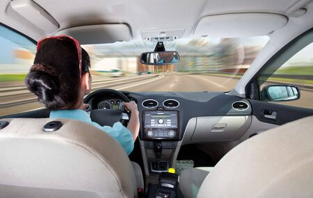 steering: women at the wheel the car Stock Photo