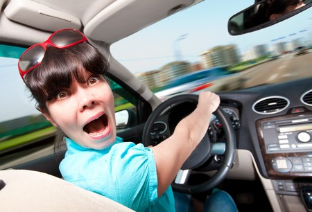hysteria: women at the wheel the car Stock Photo