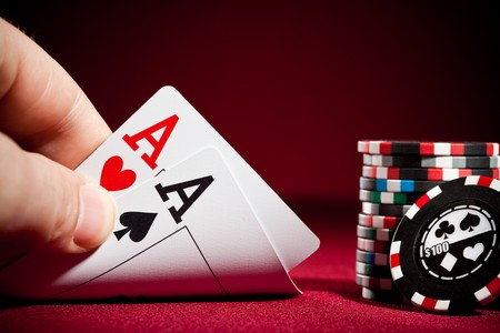poker chips: Stack of chips and two aces