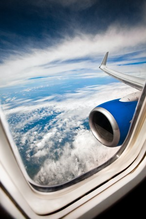 airplane window: Classic image through aircraft window onto jet engine Stock Photo