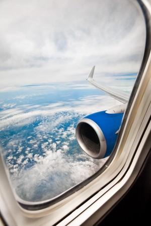 stratosphere: Classic image through aircraft window onto jet engine Stock Photo