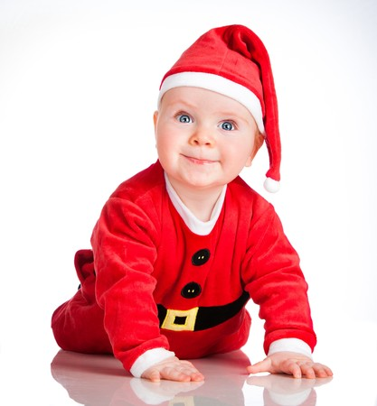 Baby In Santa Costume At Christmas on the white photo