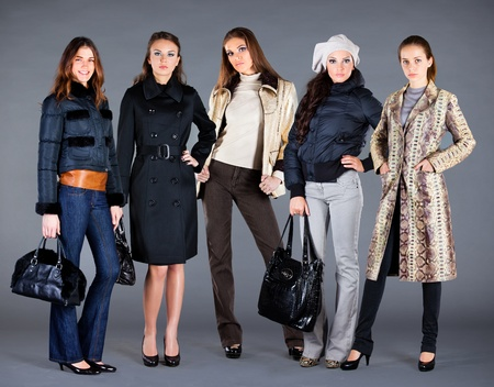 Five girls in different clothes, autumn winter collection clothes photo