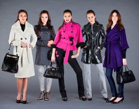 winter clothes: Five girls in different clothes, autumn winter collection clothes Stock Photo