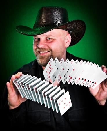 man skilfully shuffles playing cards... photo