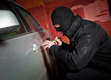 robber and the thief hijacks the car photo
