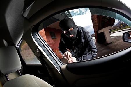 car crime: robber and the thief hijacks the car Stock Photo
