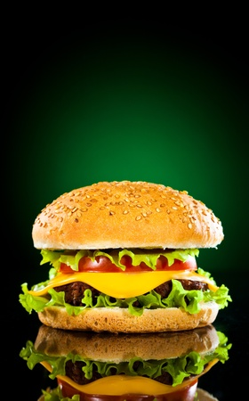 steak sandwich: Tasty and appetizing hamburger on a darkly green background Stock Photo