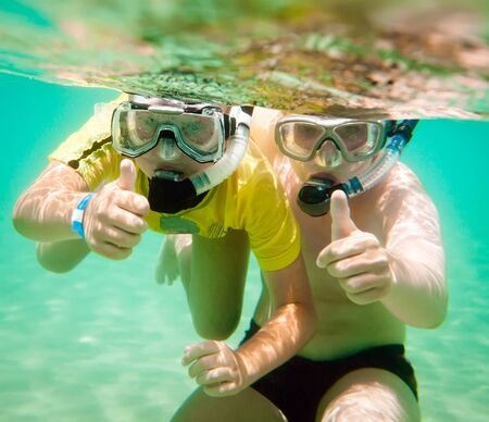 Two children under water in masks photo