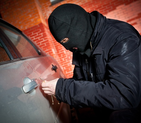 criminals: robber and the thief hijacks the car Stock Photo