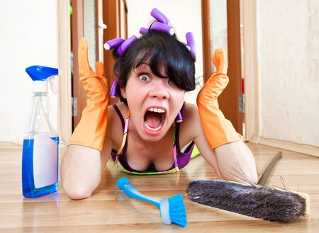 chore: housewife washes a floor in the house Stock Photo