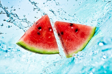 fruit drop: fresh water splash on red watermelon