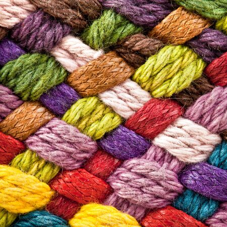 image of braided multi colored woollen yarns photo