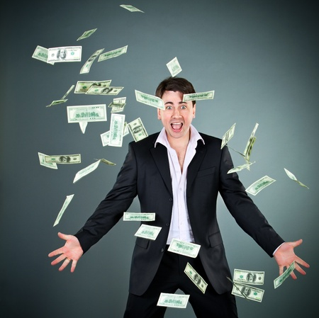man in a suit throws money Stock Photo - 9352484